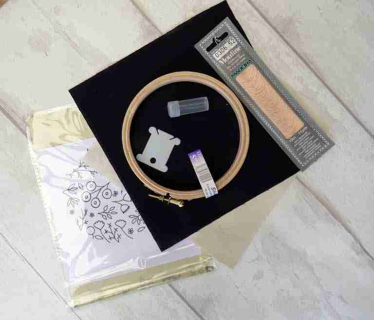 hand embroidery kit on black fabric