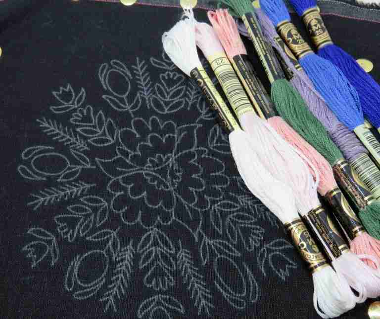 embroidery pattern on dark fabric